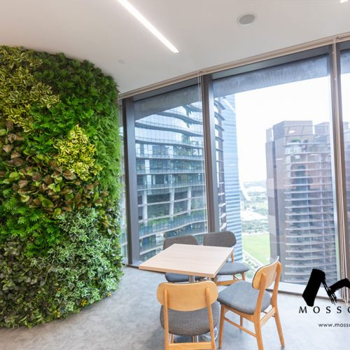 Artificial green wall incorporated into building column of office at Marina One