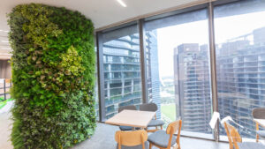 Camouflaged pillar with nature inspired interior design